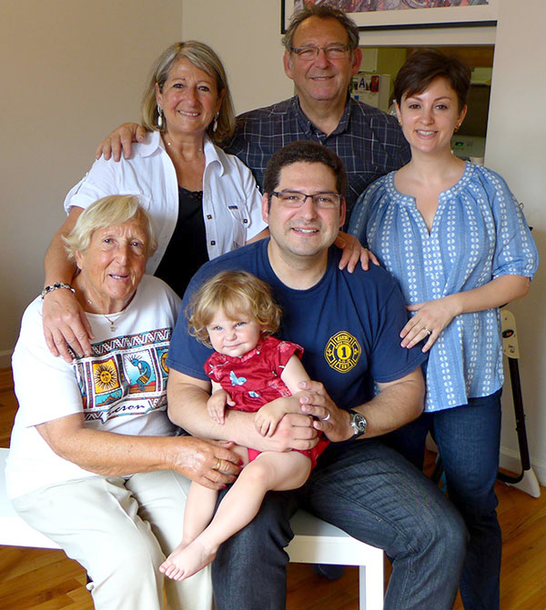 David Rak's grandmother Ginette (seated left), clockwise: David' mom X, David's Dad X, David's wife Jennifer, David (center), and his youngest daughter Léa